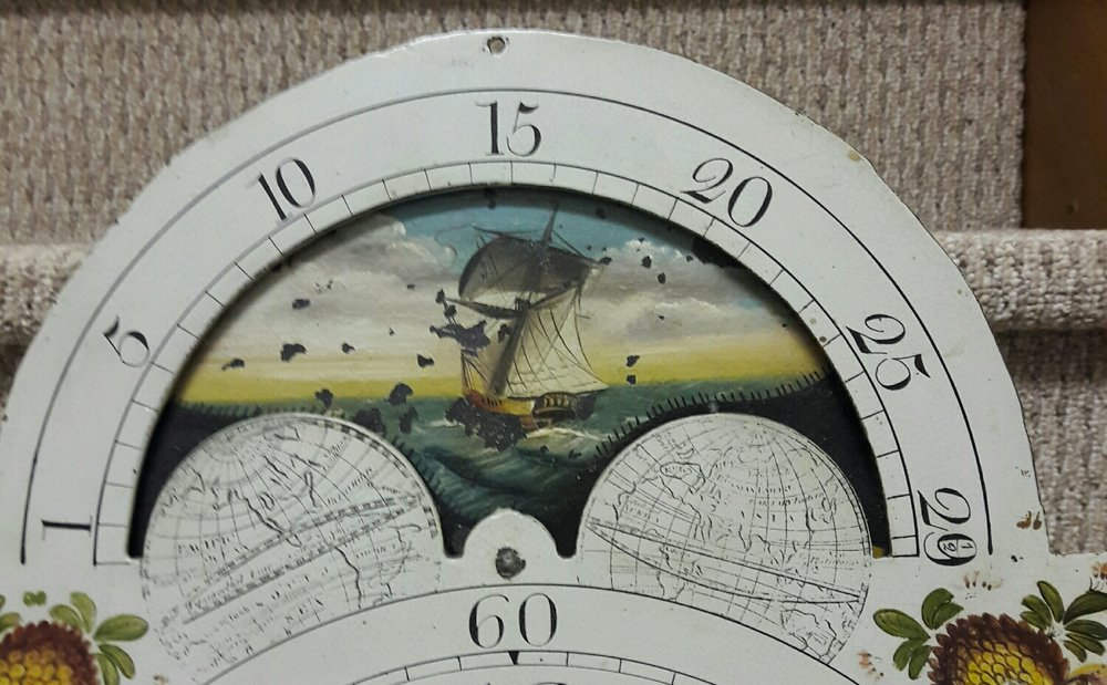 A light house and a tall ship on this moon dial.  How cape cod is that . This grandfather clock is in for an overhaul .