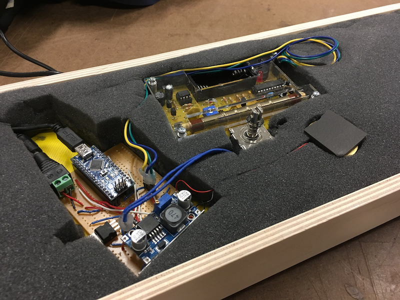 inner workings of the piece: geiger-counter, Arduino Nano, solenoid, piezo element, high-density foam to improve the acoustics of the knocks