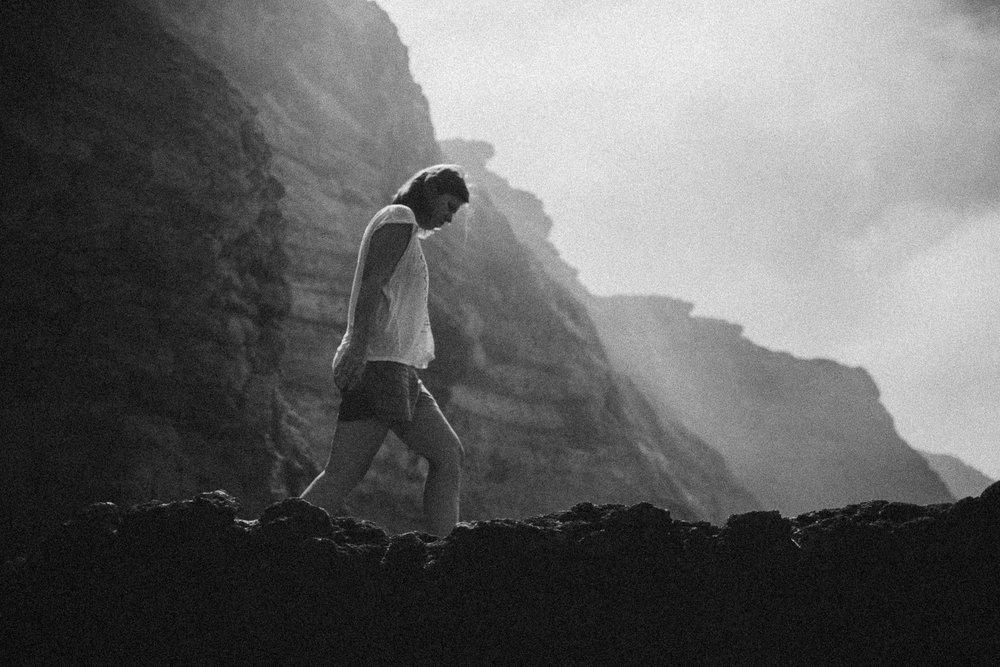 Woman-walking-on-the-rocks.jpg
