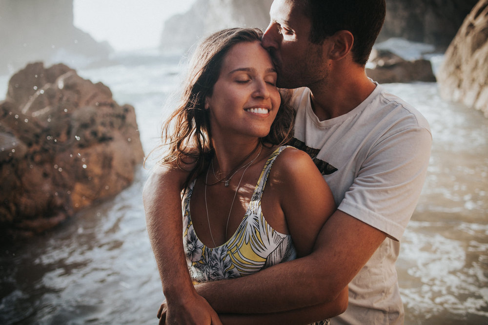 Couple is hugging at Praia da Ursa