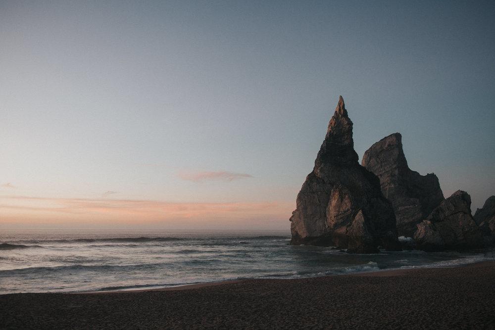 Rocks of Praia da Ursa after sunset