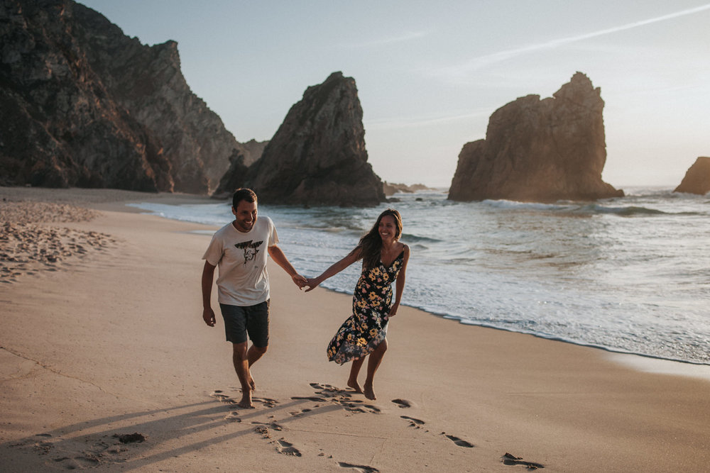 Couple walking at the beach