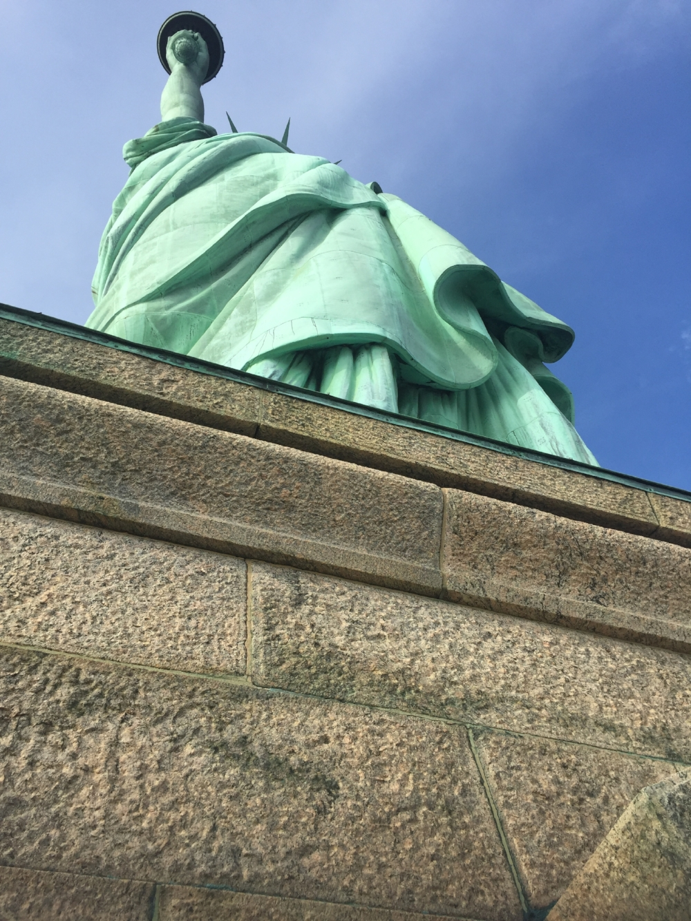 At the feet of the Statue of Liberty