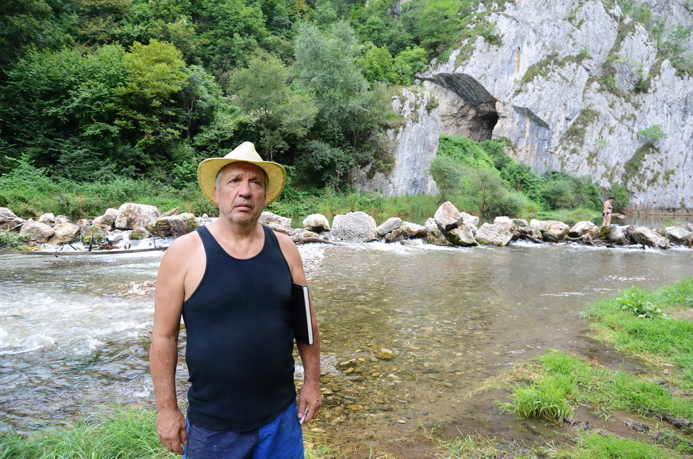 Zoran at Jerma River with Dam Project in Background, 2014