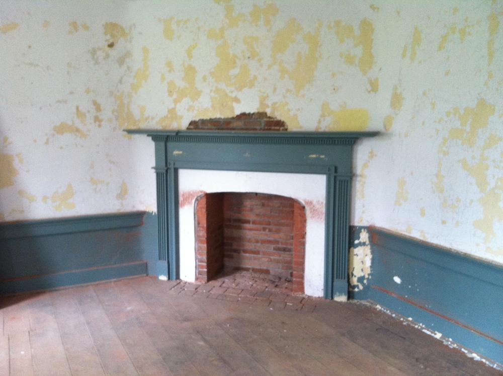 The original corner fireplace in the room where Washington actually slept (documented in his journal).
