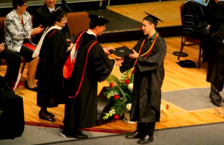 During IWU's spring commencement 2012, then-President Henry Smith hands me my diploma. (Photo by Jen Hines)
