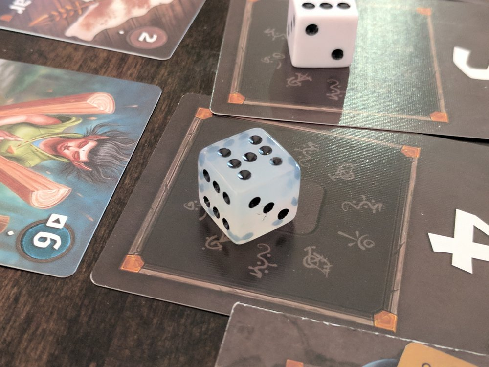 The Boost Dice are discernible form the other dice in the bag because they are a different size and shape.