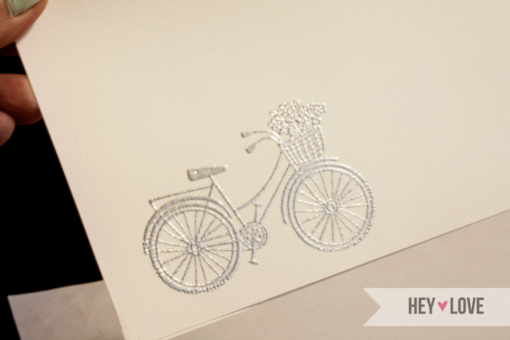 Learn how to heat emboss with stamps, embossing powder, watermark stamp pad, and a heat tool for a unique effect on your cards. Tutorial on Hey Love Designs.