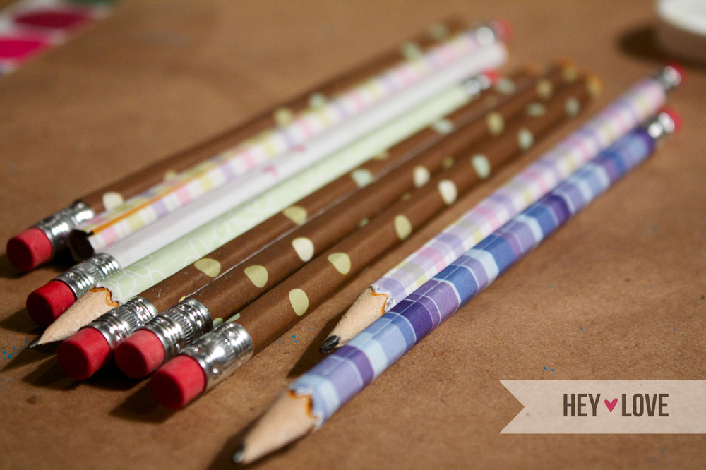 Wrapping your pencils with scrapbook paper is such an easy way to liven up your desk. Visit Hey Love Designs for the full tutorial.