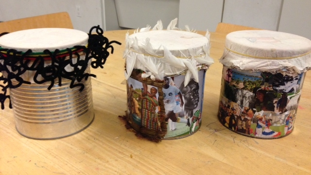 Participants of the  Hudson Guild Adult Education  program constructed drums demonstrating their cultural heritage on the surface, in a Áse Power Consulting workshop.