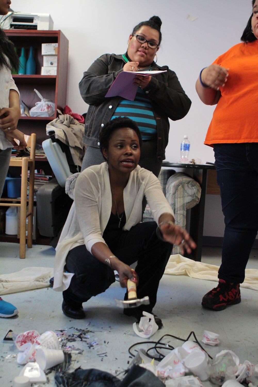 Nancy Moricette of Áse Power Consult demonstrating Destructive Theatre techniques to young participants.