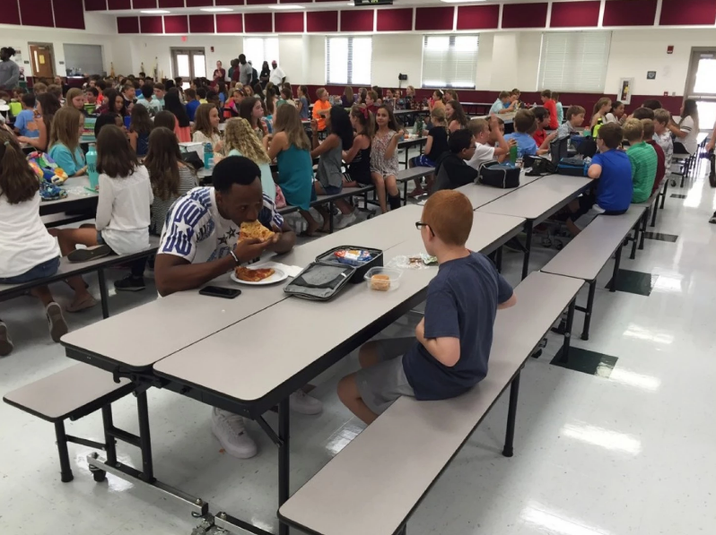 Travis Rudolph eating lunch with autistic middle schooler Bo Paske
