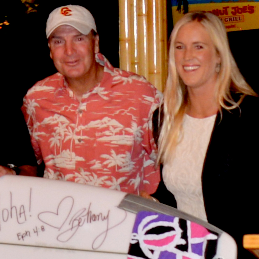 "Joe being presented an autographed surfboard from ""Soul Surfer"" Bethany Hamilton.."
