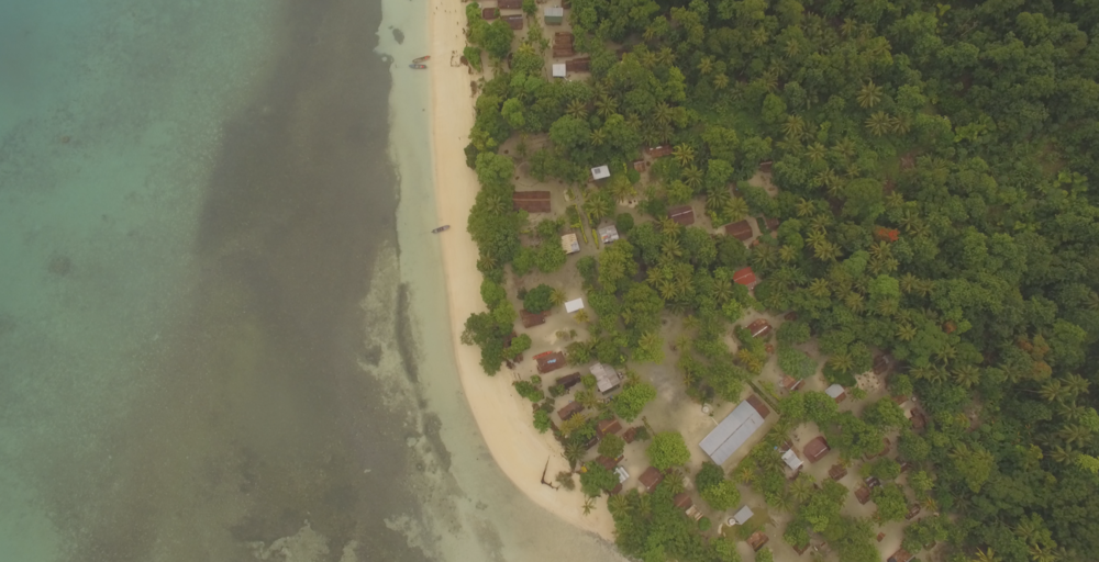An aerial shot of the thatched houses of Tuwo shows how vulnerable the community is to the sea. Some families have already moved multiple times to escape the king tide and extreme storms, rising sea levels. While the weather system will help save lives by ensuring better preparedness, the community will have to find long term solutions to the growing problems of climate change.