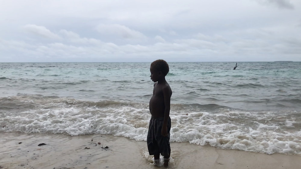 While Tuwo is protected from direct hits from cyclones because  it opens to the northeast, the sea advances relentlessly on Nathan's island. The project has helped with new wells and water tanks so the community now has time to plan a move to the mainland.