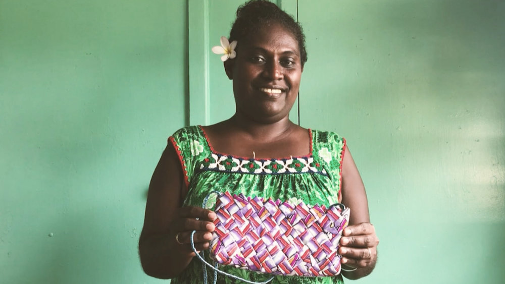 Marylin is one of the 50 women who make up Plasticwise Gizo. She uses traditional weaving techniques to turn the plastic wrappers into stylish handbags. The collective shares the profits so the women benefit but it's also starting important conversations about climate change and protecting water resources.