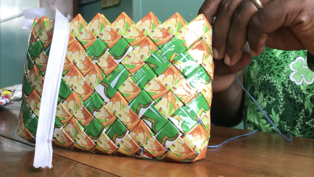 It takes more than 300 plastic wrappers to make this handbag. Each one is carefully cut and folded and then woven using traditional techniques. Plasticwise is inspiring others to find creative solutions to the waste problem in the Solomon Islands.