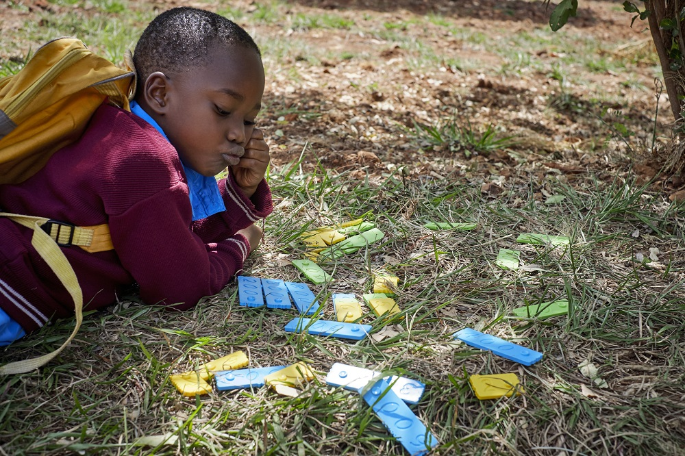 Tanzanian girl learning math with The Joy of Numbers