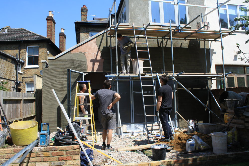 Builders on site with scaffolding