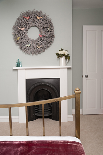 S St. Master bedroom Chimney with bed.jpg