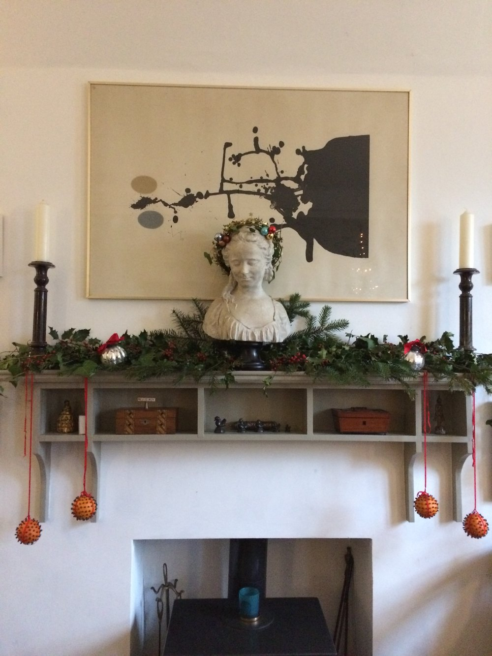 Traditional natural foliage, glove oranges for scent, candle and a centre piece from Nicky Percival Ltd