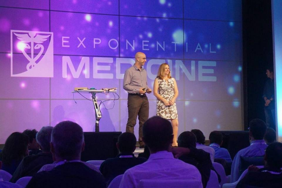 Arnon Zamir, Founding Director of TOM with Stacy McCarrell Ruddick, mother of three children with Angelman Syndrome - on the mainstage of Exponential Medicine
