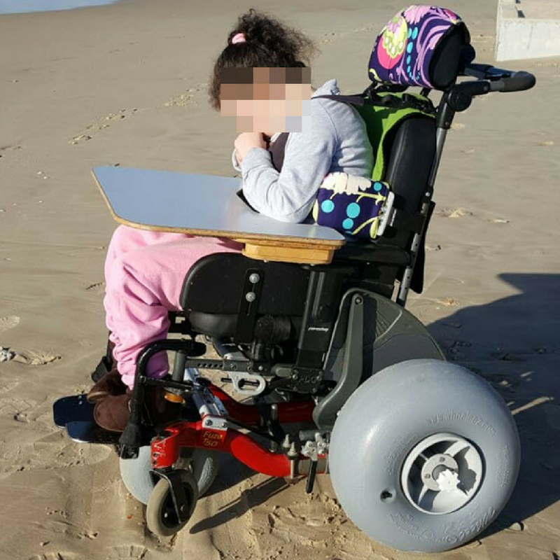 Beach chair    A wheel add-on that allows any wheelchair to travel on sand