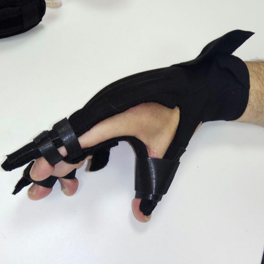 Flexi Glove  A glove for people who suffer from spasm in their wrist, with their fingers closed, such that it stretches them back and allows to restore a certain level of functionalty.