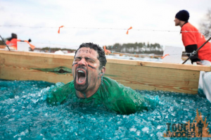 """Arctic Enema: This obstacle is all about mental grit. Many athletes use ice baths for recovery, but you'll have a difficult time relaxing your muscles in this freezing skip. First you must jump bravely into Big Mudder's floating iceberg abyss. Once submerged, find the mental and physical strength to swim through the ice, under a wooden plank and pull yourself out on the other end before hypothermia sets in."" (Toughmudder.com)"