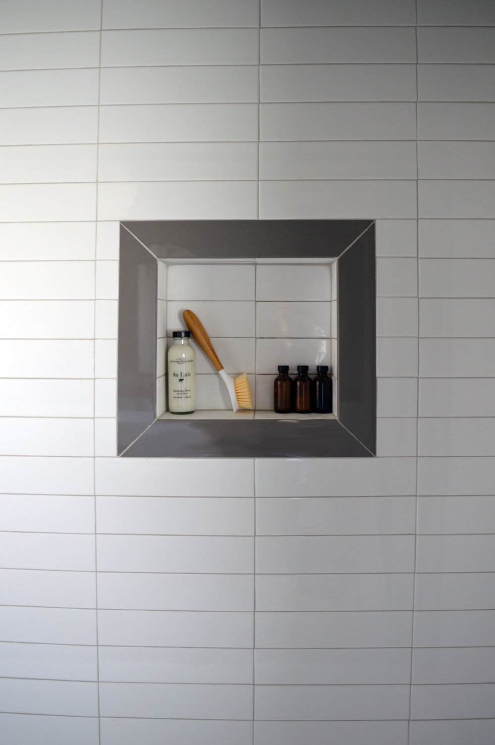 Stacked subway tile shower niche