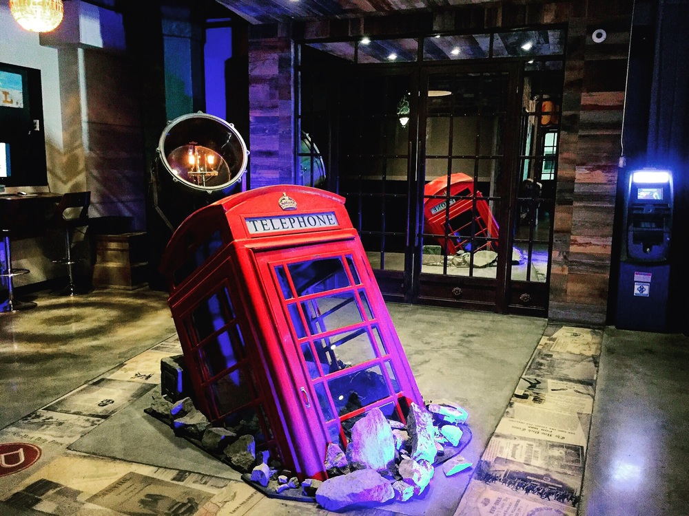 The lobby's centerpiece is a British style telephone booth protruding from the floor, which is laminated with old New York City newspapers to remind guests about the building's former life.