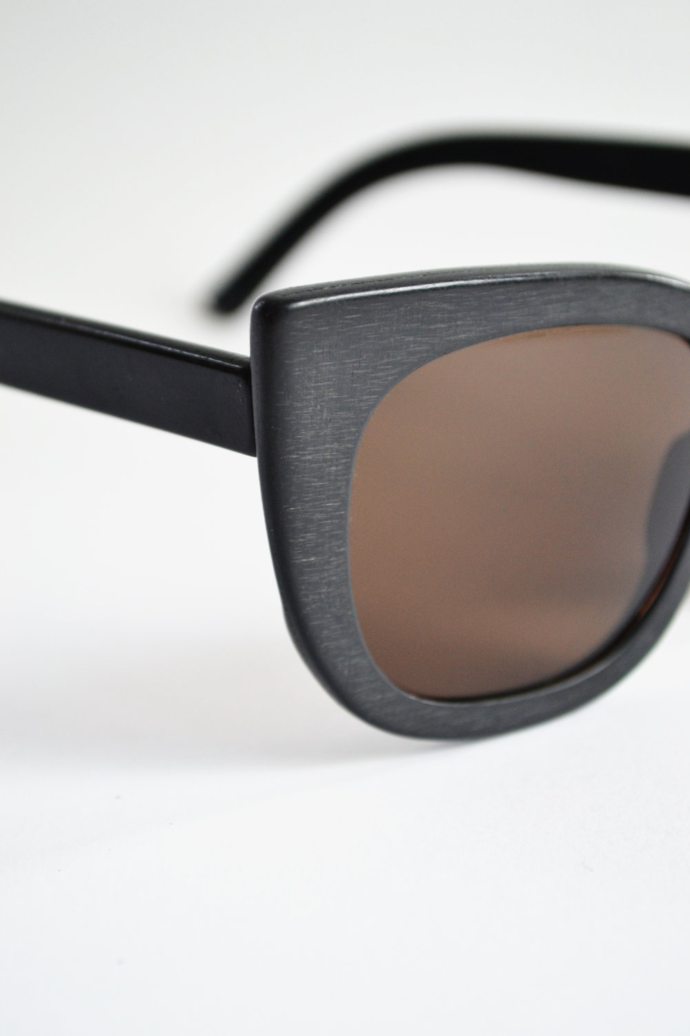 Sunglasses 3D-printed from the recycled plastic of a car dashboard, by w.r.yuma