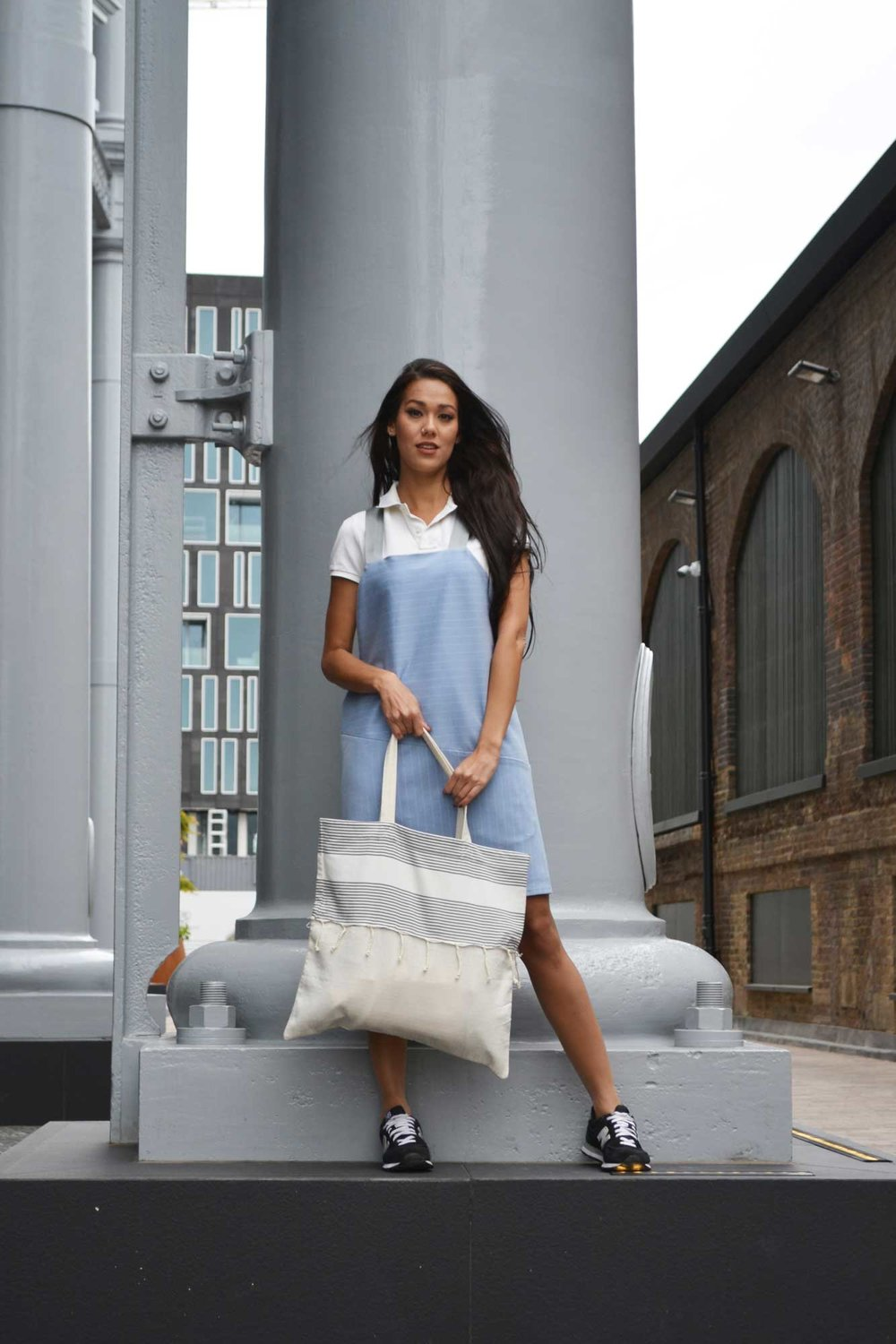 Bruna Costa models the  Beach Bag in Grey Stripes , photographed by Ana Carneiro