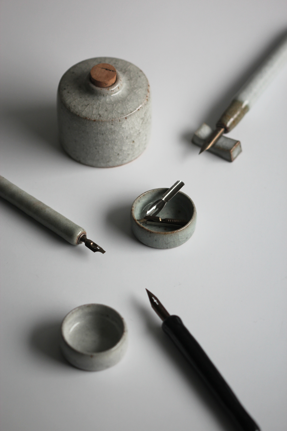 Hand thrown pens, palettes and inkwell.