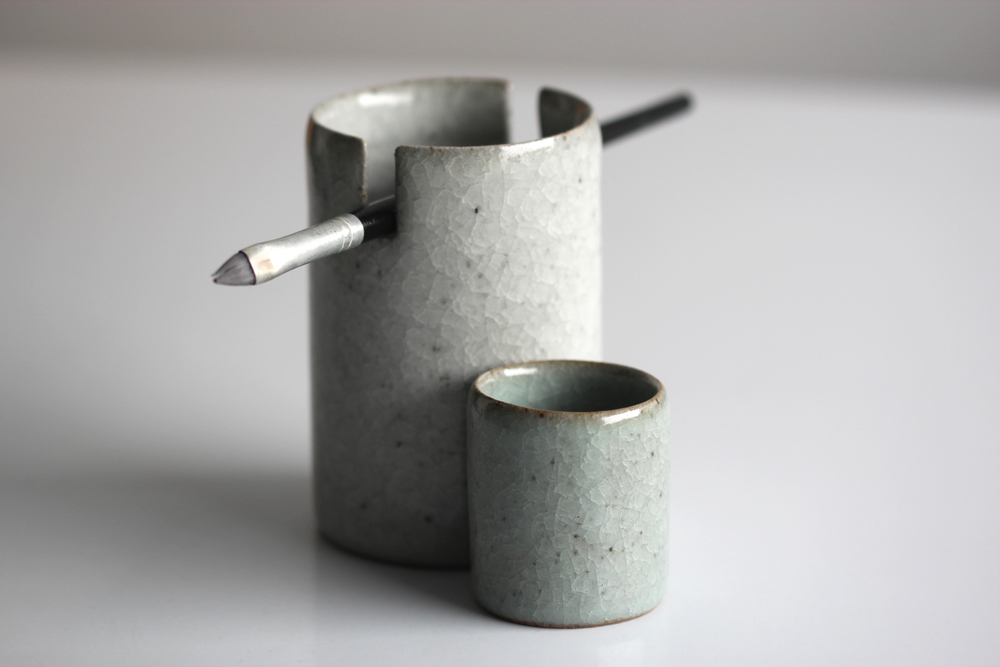 Brush-holder and waterpot, both with a crackle glaze of altering iron content.