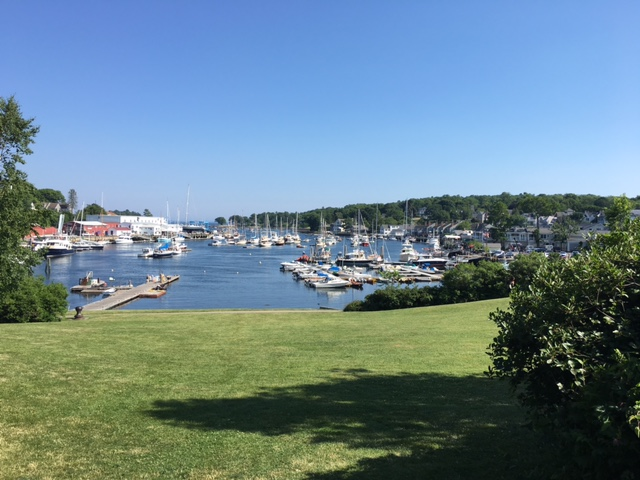 The view of the harbor in Camden, Maine taken from the paved path on the edge of downtown.