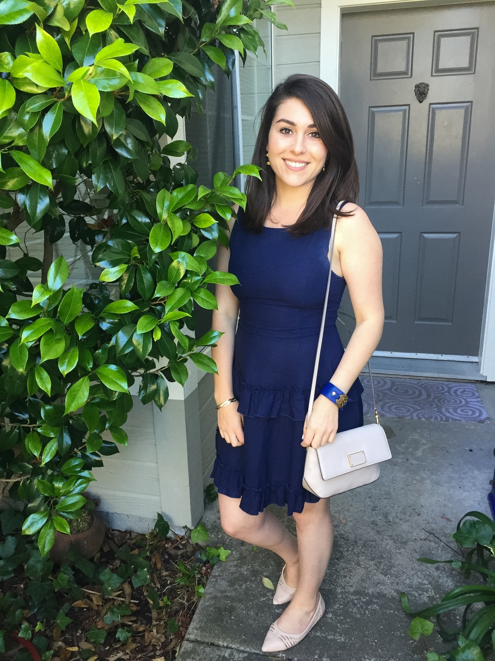 Denim dress from Nordstrom Rack with neutral flats from Express, a Marc by Marc Jacobs crossbody bag and a blue Tory Burch bracelete