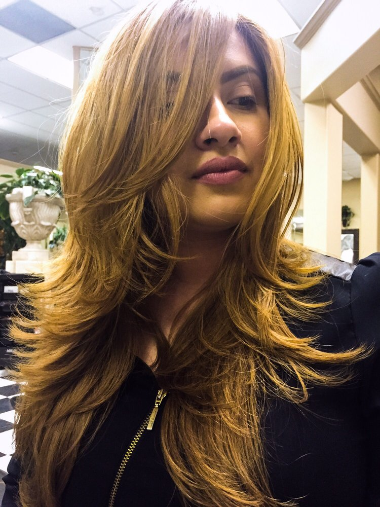 Beige blond hair color and long layer cut