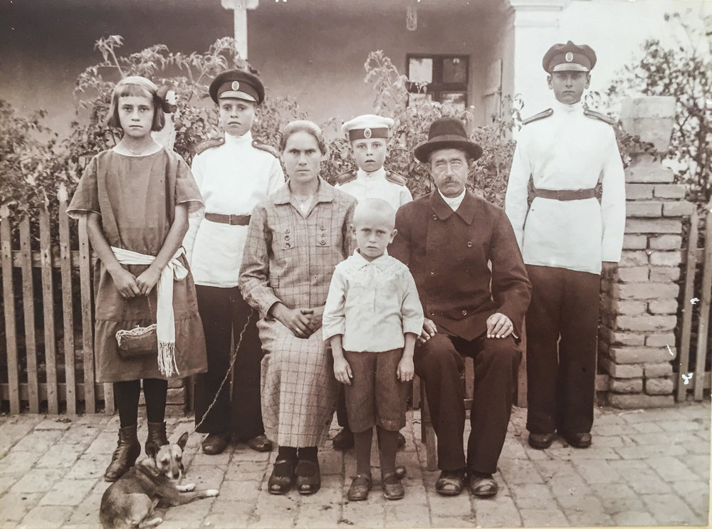 Daria Pavlovna Romanova Amochaeva with her family. My father Anatoly is the taller boy between his mother and father. Early 1920s in Serbia.