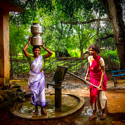 Women have to carry water long distances in tribal areas of Odisha, India, and sometimes are reluctant to be photographed at the source. This woman clearly didn't mind at all, and paused with over 40 pounds of water on her head to smile at me.