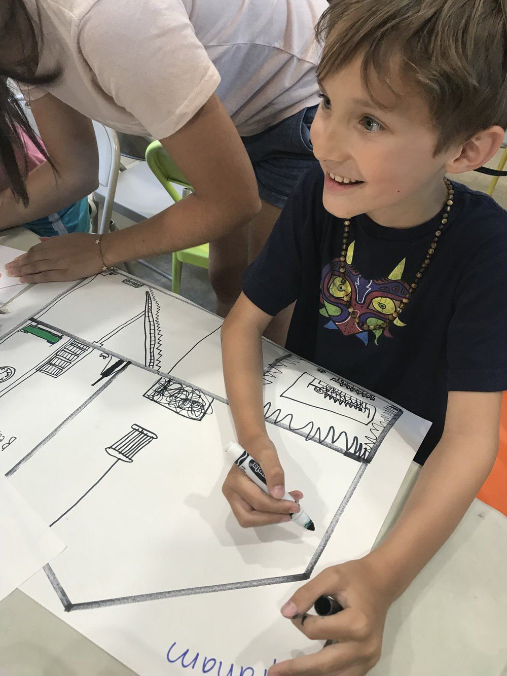 Working on blueprints and floor plans for our miniature houses.