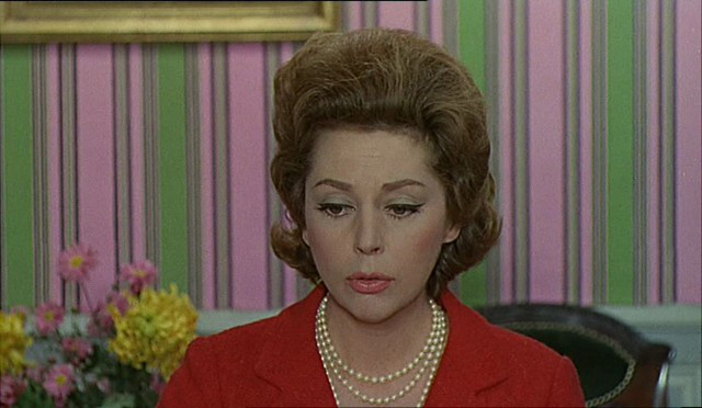 "Anne Vernon as Madame Emery in ""Les Parapluies du Cherbourg"".  Not only do we share a first name, but we were also born on the same day, have reddish hair, and can rock a pantsuit."