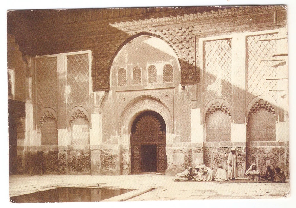 Teachers with their students at Medrasa Ben Youssef, Marrakesh,  Morocco . 1910s by Felix. This 14th university is the largest in Morocco and is a famous historical attraction in Marrakesh.