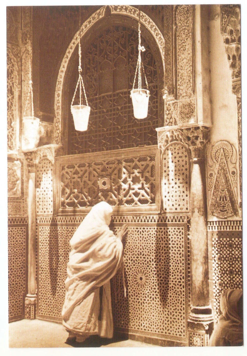 A pilgrim greeting the tomb of Moulay Idriss II, founder of Fez,  Morocco , in 1930. Anonymous.