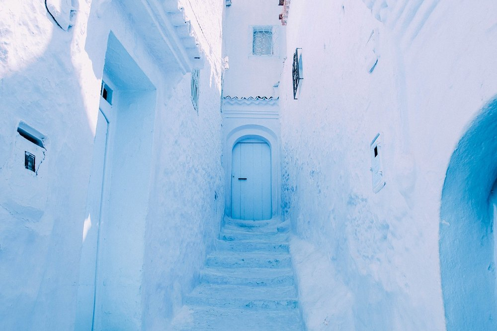 Chefchaouen - Nestled amongst the peaks of the Rif, the blue-washed town of Chefchaouen is known for its colorful souks and beautiful hand woven woolen crafts.