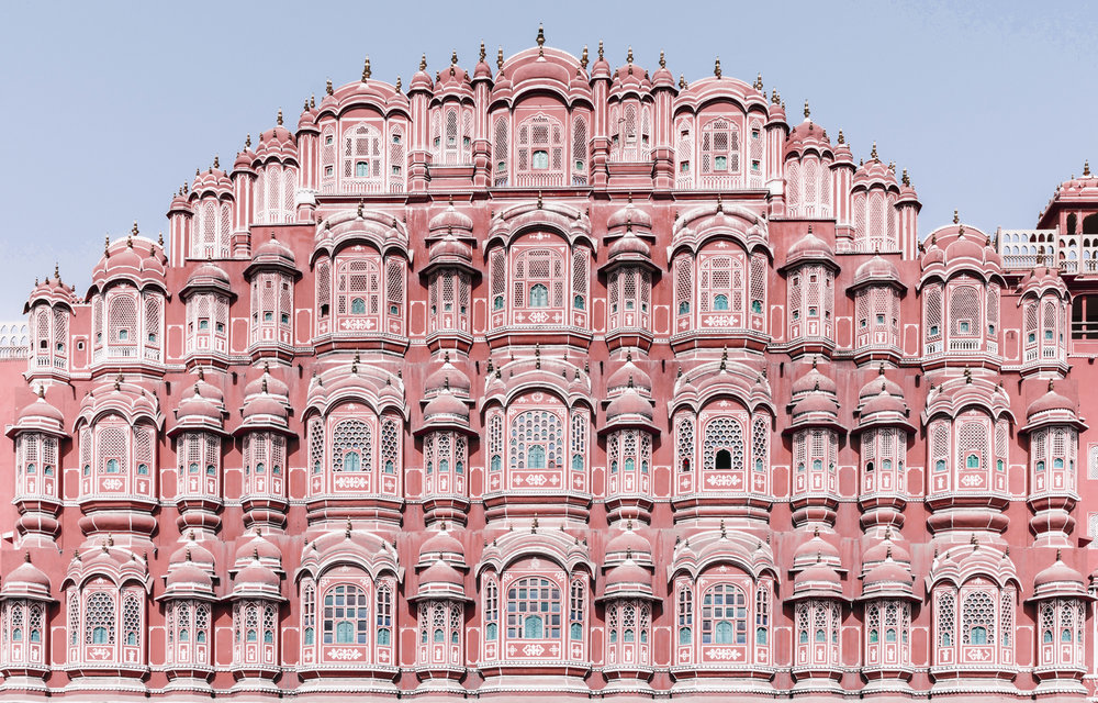 Jaipur - Palaces left, right and center. This city was once a prestigious capital and what's left today is a spectacle of color-fringed windows, breathtaking doorways and buzzing markets filled with handmade crafts and textiles.