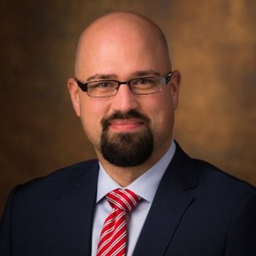 Justin C. Woody   Chief Operating Officer