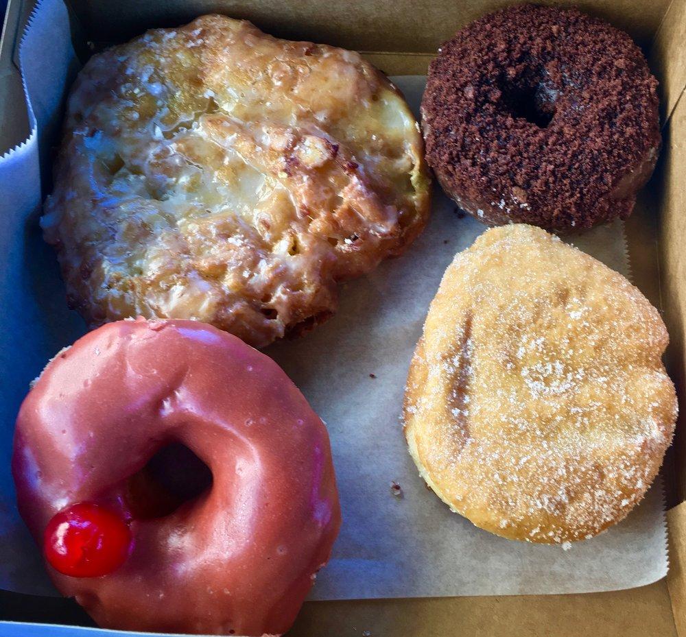 apple fritter chocolate chocolate cake raspberry jelly and cheerwine donuts