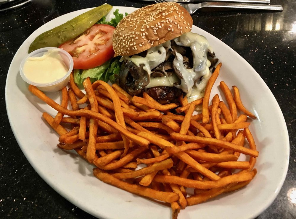 mushroom Swiss burger with sweet potato fries