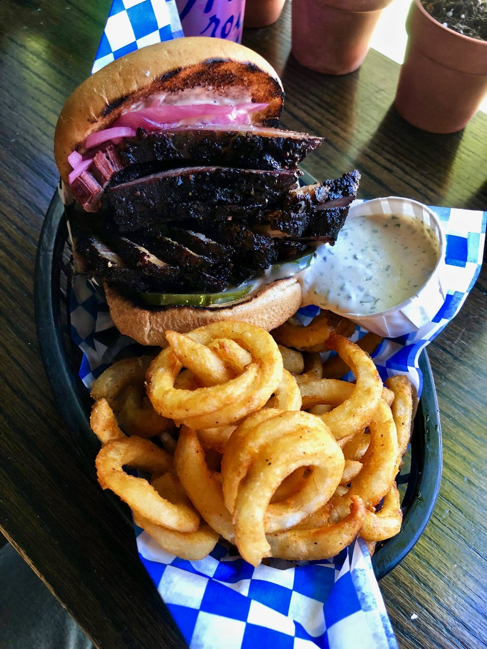 brisket sandwich with curly fries